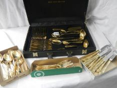 A gilded 12 place setting cutlery set by Besteoke Solingen, Germany.