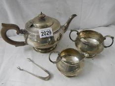 A 3 piece hall marked silver tea set and sugar nips, 684 grams.