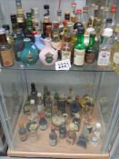 2 shelves of spirit miniatures etc.