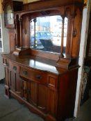 An early 20th century oak mirror back dresser in good order.