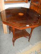 An Edwardian mahogany inlaid octagonal table.