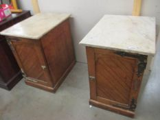 A pair of old bedside cabinets with marble tops and heavy brass hinges, possibly Scottish.