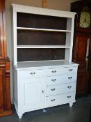 An early 20th century painted pine dresser.
