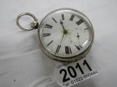 A silver verge pocket watch, George Fowler, Horncastle, in working order.