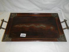A Chinese rosewood tray with silver embellishments including dragon in centre.