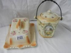 An old biscuit barrel and a cheese dish, in good condition.