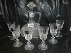 An unusual shaped Edinburgh crystal decanter and 6 Edinburgh crystal glasses.