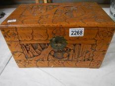 "A carved camphor wood box, 12"" wide, catch broken."