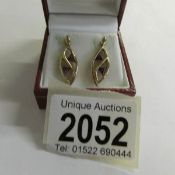 A pair of amethyst ear pendants in 9ct gold.