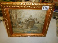 A gilt framed Italian antique embroidery depicting Jesus Christ at a well with a woman.