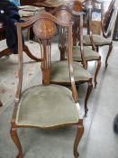 A set of 4 mahogany inlaid chairs.