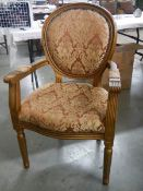 A French gilded arm chair.
