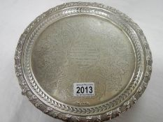 A hall marked silver presentation tray dated 1868, approximately 588 grams.