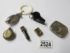 A penguin rattle, 2 cigar cutters, a sovereign case, a coin case and a whistle.