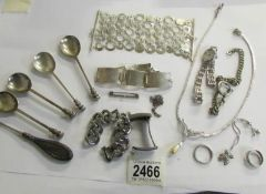 A mixed lot of silver items including silver spoons, necklace, bracelet,