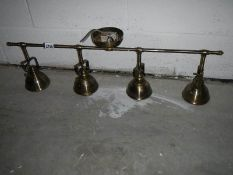 A 4 lamp adjustable ceiling light (all angles).