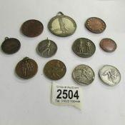 11 vintage sports medals.
