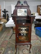 An Edwardian mahogany cabinet signed for Chanel No. 5.