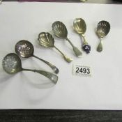 4 silver plate caddy spoons and 2 sifter spoons.