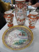 A pair of Chinese vases, a larger vase and a plate.