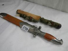 2 20th century knives including one with handle shaped as head.