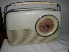An old Bush radio, TR82, in working order, slight chip to corner.