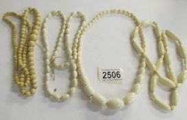 4 ivory necklaces.