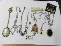 A mixed lot of pendants, necklaces etc.