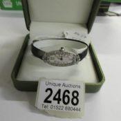 An art deco platinum ladies wrist watch set with diamonds, approximately half carat,