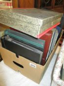 An interesting box of stamp albums, postcards,