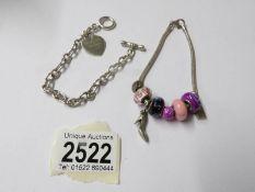 A Pandora style bracelet and a silver bracelet.