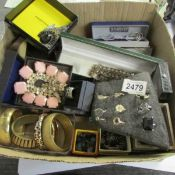 A large mixed lot of assorted costume jewellery.