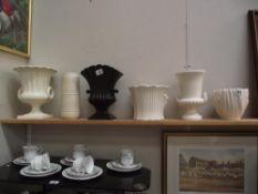 A quantity of planters/vases/urns including Sylvac, Wedgwood etc.