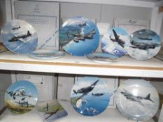2 shelves of boxed of aviation collectors plates