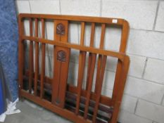 An Arts and Crafts style carved bed frame (header,