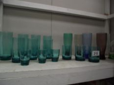 A quantity of vintage coloured drinking glasses