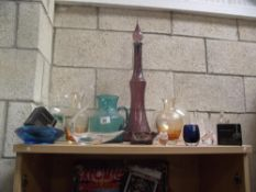 A selection of coloured glass vases, bowls, ornaments etc.
