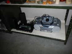 A Panasonic cd player and one other item.