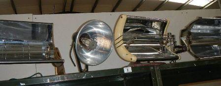 4 vintage electric heaters.