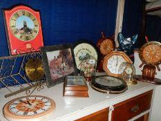 A quantity of modern wall clocks.