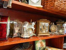 A large quantity of mantel clocks and Binatone phones.