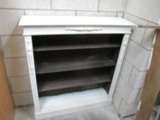 A white painted and dark stained book case (possibly pine)