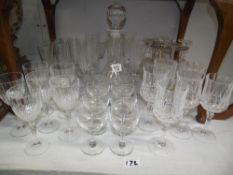 A quantity of glasses including crystal and a decanter etc.
