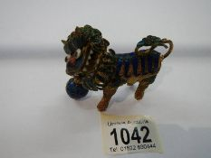 A Chinese jewelled dragon figure with nodding head.
