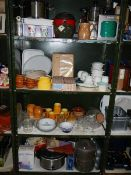 4 shelves of kitchenware including some new items.