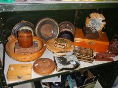 A shelf on miscellaneous wooden items including boxes.