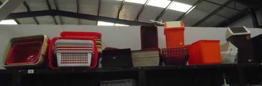 A mixed lot of plastic storage containers etc.