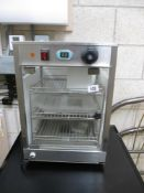 A glass sided commercial counter top food heater cabinet
