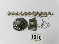 A 1970/80's oblong pendant, a French Le Farre 1950's bracelet and a blue stone brooch.