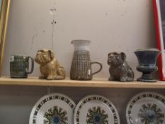A pair of pottery bulldogs,